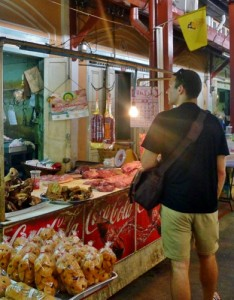 Overwhelmed by travel guilt in a delicious market